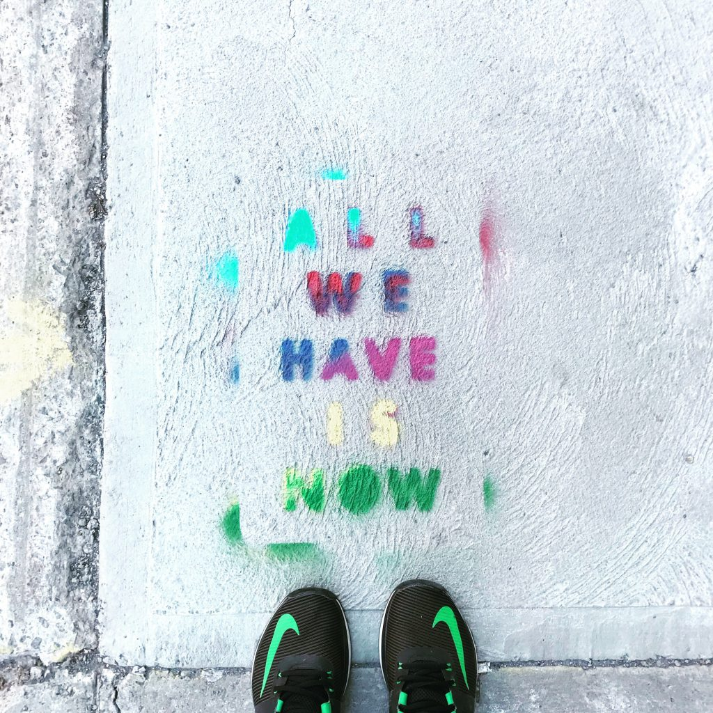 Running shoes with quote on ground